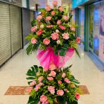 Sweet Pink Opening Flowers Stand